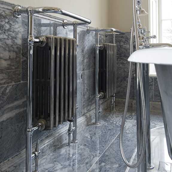 floor mounted towel rail with integral radiator
